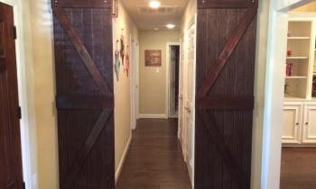 These beautiful barn doors lead you into a Western themed adventure.
