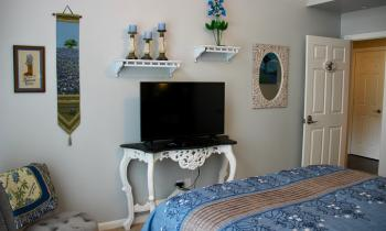 Bluebonnet Room has a smart flat screen tv and blu-ray player