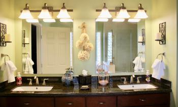The Lantern bathroom contains a walk-in shower, stand-alone tub, and double sink