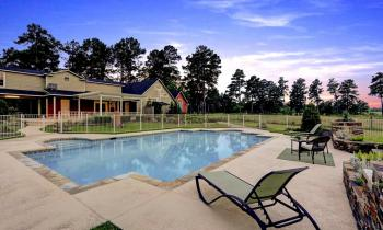Enjoy yourself out by our saltwater pool, surrounded by acres of grass and trees