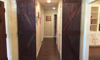 Enter through the barn doors into the Lone Star Suite.